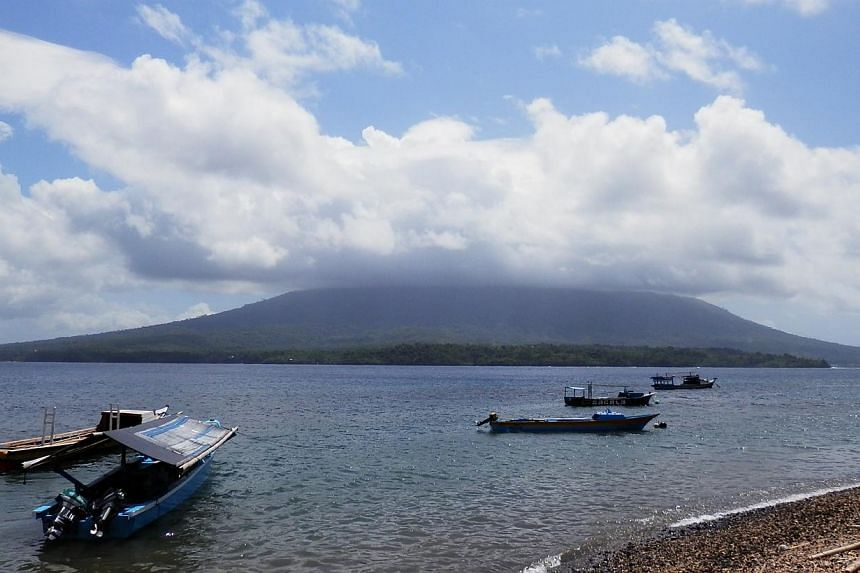 The volcano, Mount Gamalama - which forms the entire island of Ternate in North Maluku province - erupted late Thursday and was still coughing up ash the following day.-- ST PHOTO: ZAKIR HUSSAIN