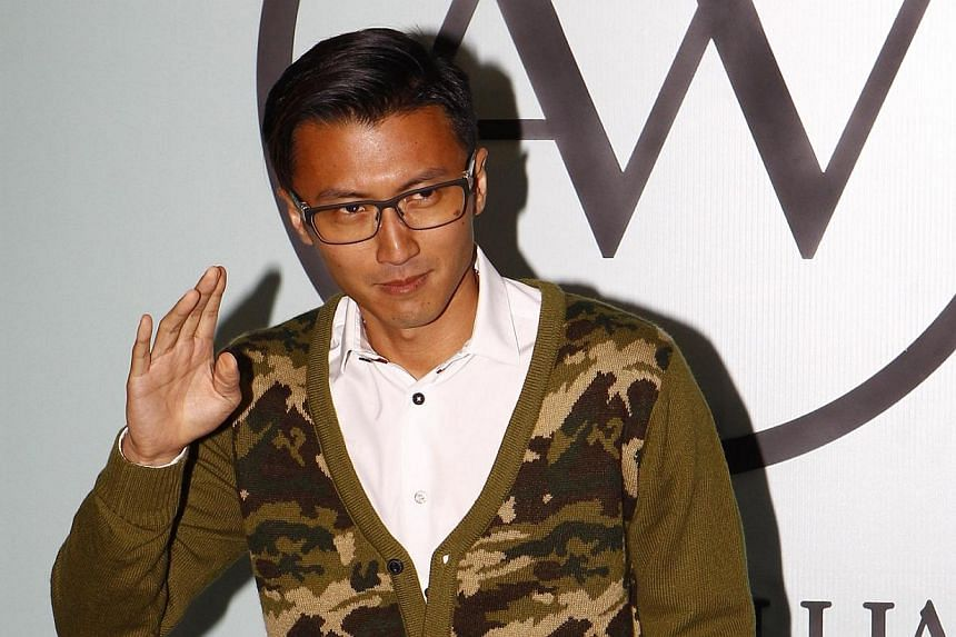 Nicholas Tse batted away talk that he is to wed lover Faye Wong, as the media questioned him if he planned to settle down in Beijing. -- PHOTO: APPLE DAILY