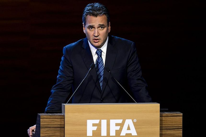"""A file photo taken on June 11, 2014, shows FIFA ethics prosecutor Michael Garcia delivering a speech during the 64th FIFA congress in Sao Paulo.Fifa executives have unanimously agreed on Friday to publish a """"legally appropriate version"""" of a di"""