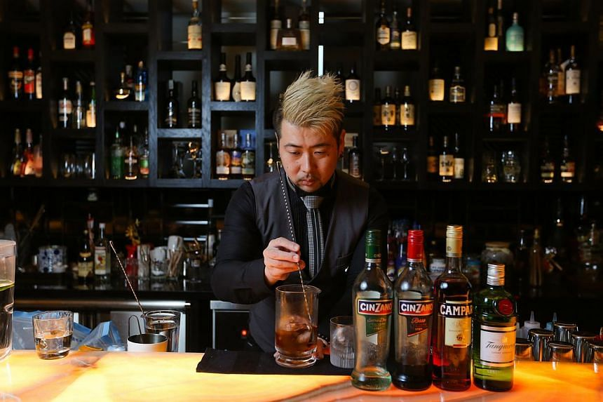 Japanese bartender Yutaka Nakashima (above) uses unusual ingredients in his cocktails. -- ST PHOTO: ONG WEE JIN