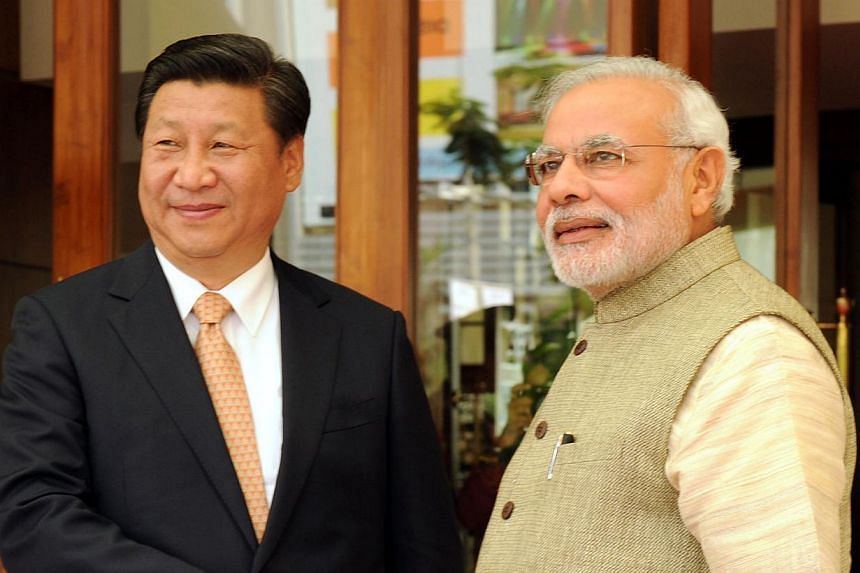 Mr Xi being greeted by India's Prime Minister Narendra Modi in Ahmedabad in September. Mr Xi's overseas travels have paid off as the survey shows he is rated better in countries he has visited.