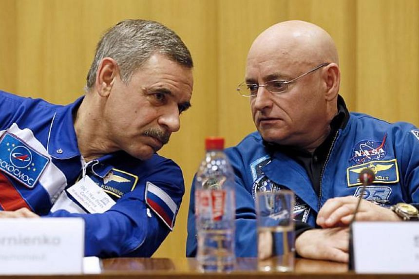 Nasa astronaut Scott Kelly (right) and Roscosmos cosmonaut Mikhail Kornienko of Russia give a press conference on Dec 18, 2014 in Paris. The pair,gearing up for the longest-ever flight on the International Space Station, said on Thursday