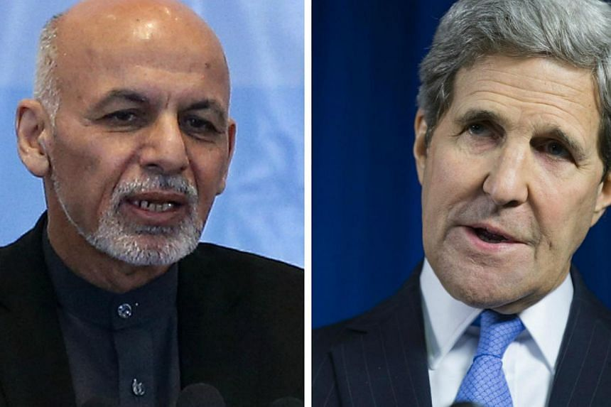 Afghan President Ashraf Ghani (left) and US Secretary of State John Kerry are among those with thankless political jobs, according to the writer. -- PHOTO: REUTERS