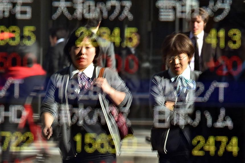 Japanese stocks led Asian markets higher on Friday, after Wall Street boasted its biggest two-day advance since late 2011. -- PHOTO: AFP