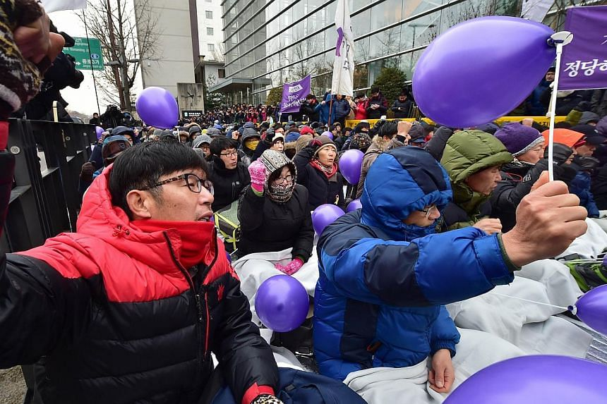 Members of South Korea's Unified Progressive Party (UPP) chanting slogans during a rally on a street near the the Constitutional Court in Seoul on Dec 19, 2014 after the court ruled the government's petition to disband the party. South Korea's nascen
