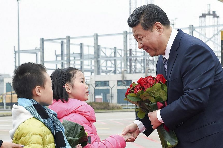 Chinese President Xi Jinping shaking hands with a child as he receives a bouquet upon arriving in Macau to celebrate the 15th anniversary of its handover to the mainland on Dec 19, 2014. Macau's gambling take, which makes up 80 per cent of its revenu