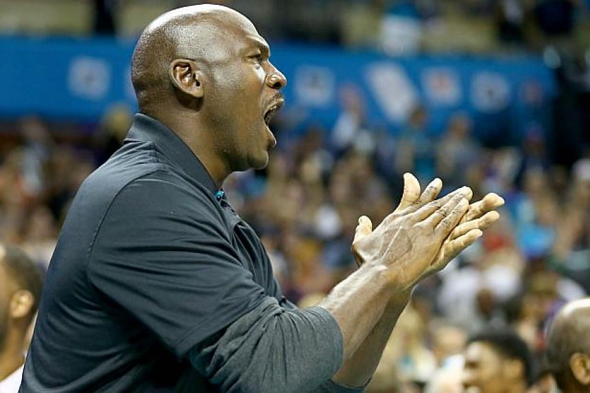 Michael Jordan, owner of the Charlotte Hornets, looks on during their game against the Milwaukee Bucks at Time Warner Cable Arena on Oct 29, 2014 in Charlotte, North Carolina. A pair of sneakers worn by Michael Jordan when he played basketball a