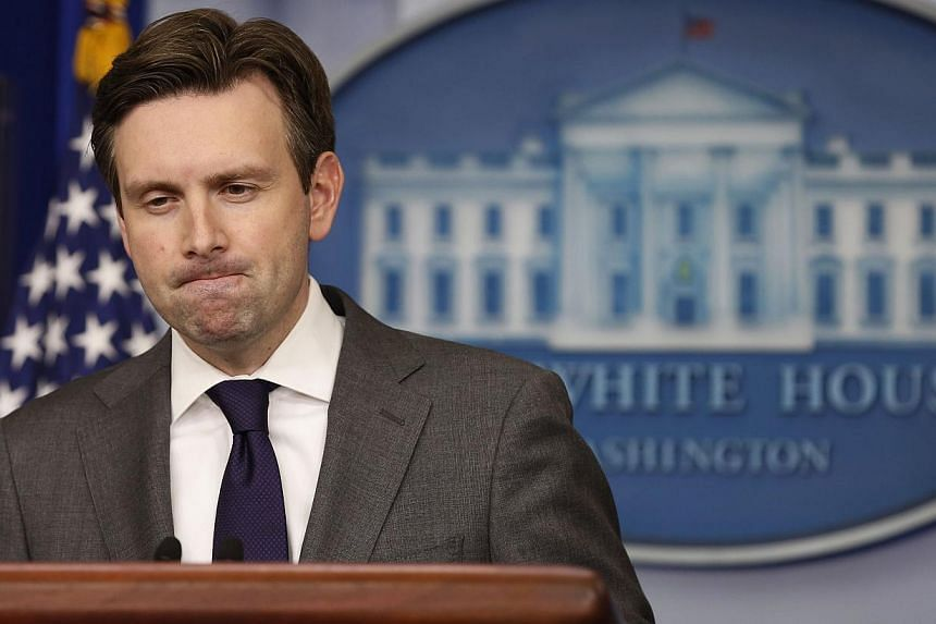 White House press secretary Josh Earnest pauses while answering a question about North Korea at the White House in Washington, Dec 18, 2014. Mr Earnest said he was not in a position to confirm North Korea was responsible for a cyber attack on Sony Pi