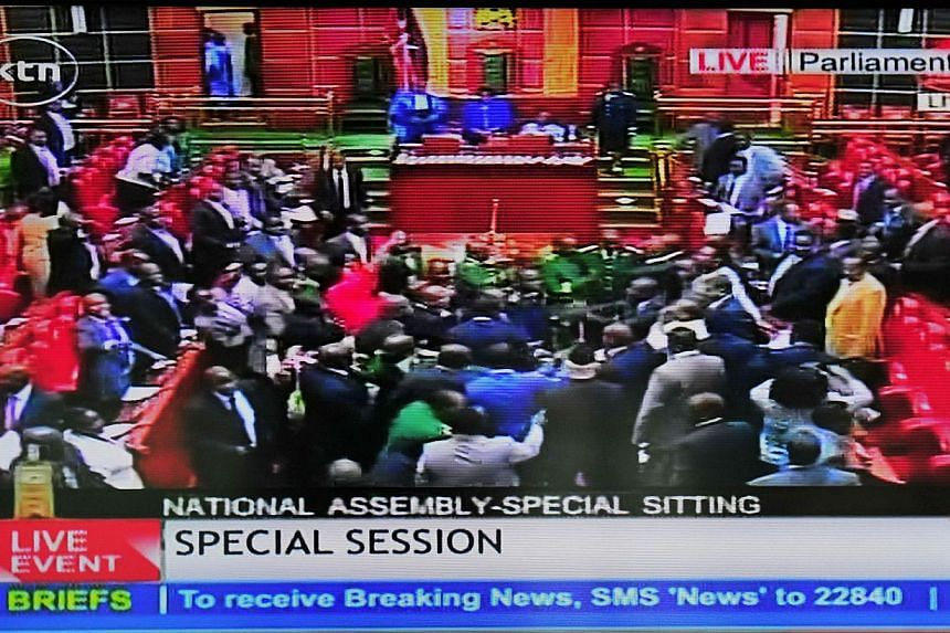 An image grab taken from a video by Kenya Television Network on Dec 18, 2014 shows scuffles breaking out in Kenya's parliament in Nairobi, delaying a vote on controversial legislation that would give the authorities sweeping powers to pursue terroris