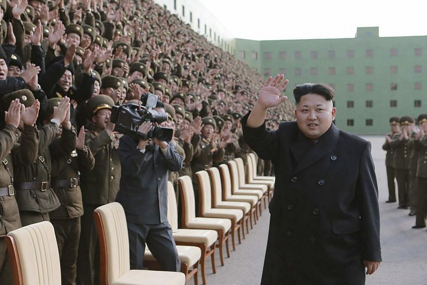 North Korea's leader Kim Jong Un attends a photo session with the participants of a meeting of Korean People's Army battalion commanders and political instructors in this undated photo released by North Korean news agency KCNA in Pyongyang Nov 5, 201
