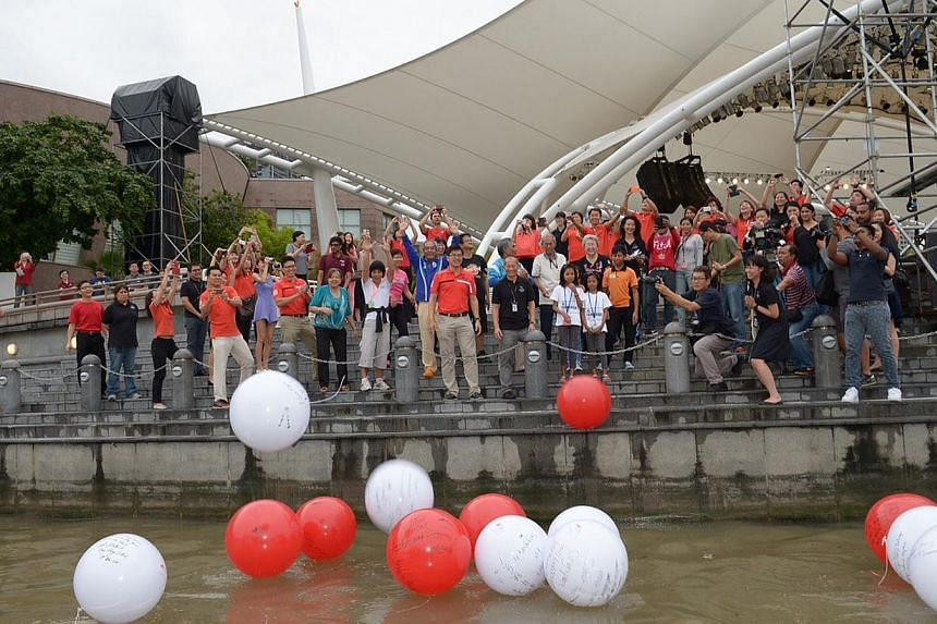 Picture of people tossing balls, plus of some of the beneficiaries.-- ST PHOTO:DESMOND WEE