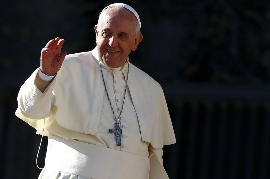Pope Francis waves as he leaves at the end of his general audience in Saint Peter's Square at the Vatican on Dec 17, 2014. He said on Friday thathe will not still be in the Vatican in 10 years' time.-- PHOTO: REUTERS