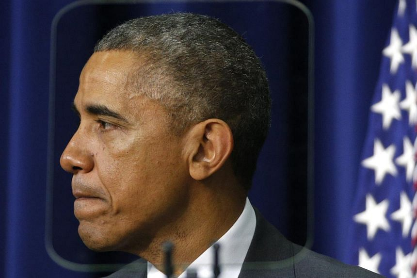 President Barack Obama (above) said on Thursday he had signed into law a new Russian sanctions Bill passed by Congress but did not intend to impose further sanctions against Moscow for now. -- PHOTO: REUTERS
