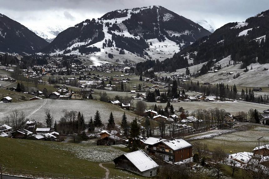 A picture taken on Dec 11, 2014 shows the Swiss resort of Gstaad, with little snow. In France,one ski resort that has been blessed with snowfall has been forced to impose quotas to prevent a run on its slopes. -- PHOTO: AFP