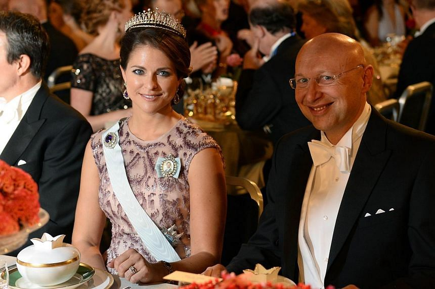 Princess Madeleine of Sweden (left) and the 2014 Nobel Prize in Chemistry laureate Stefan W. Hell attend the Nobel banquet, a traditional dinner after the Nobel Prize award ceremony at the Stockholm City Hall on Dec 10, 2014. -- PHOTO: AFP