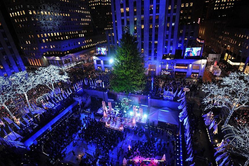 A view of the Rockefeller Center during the  82nd annual Rockefeller Christmas Tree Lighting Ceremony. The United States issued a worldwide travel alert on Friday, warning Americans to be vigilant during the holiday period. -- PHOTO: AFP