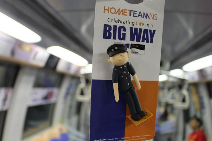 Some 20,000 figurines will be given out on MRT trains from now till March next year as part of a HomeTeamNS campaign to recognise the Home Team's national servicemen and their families.-- PHOTO: HOMETEAMNS