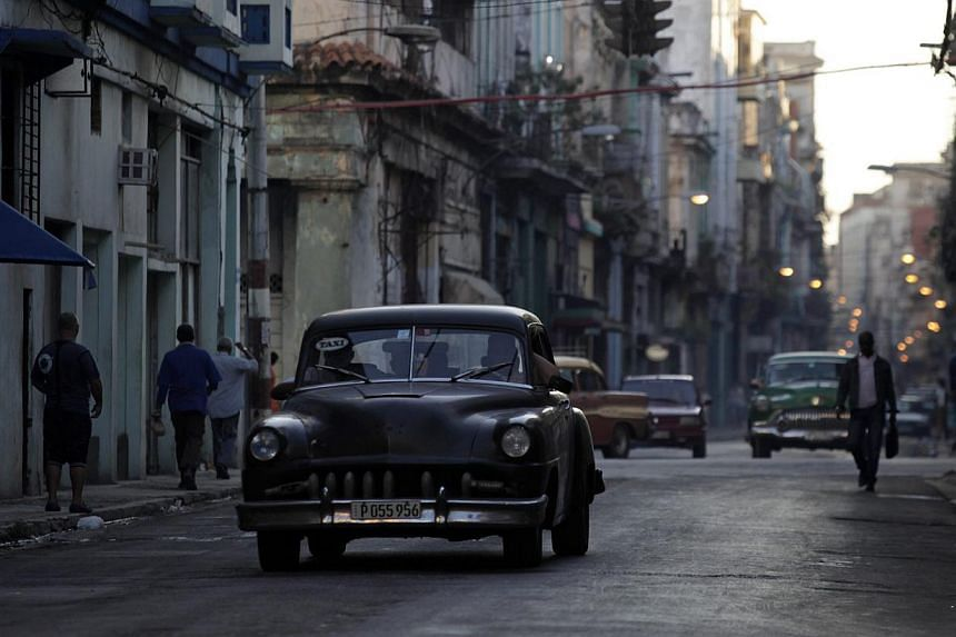 A car used as a taxi drives through the streets of Havana Dec 19, 2014.Cuba's parliament on Friday unanimously ratified a deal reached between Havana and Washington normalising relations after a half-century of hostility. -- PHOTO: REUTERS