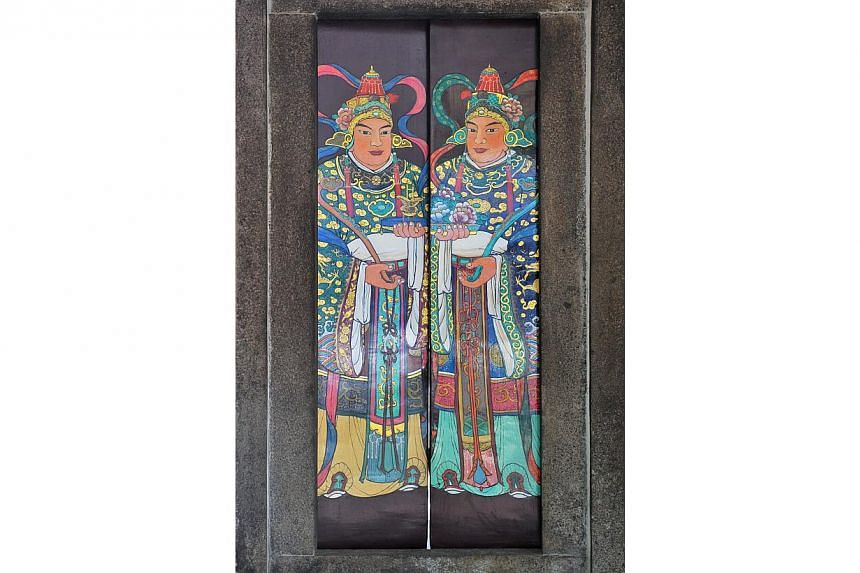 The entrance door guardians.-- PHOTO: LIM YAOHUI FOR THE STRAITS TIMES