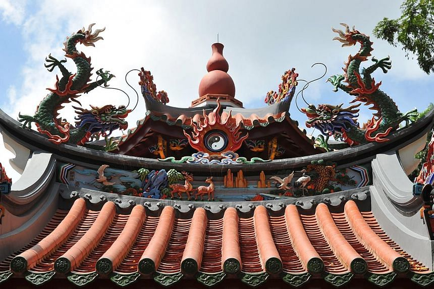 The guarding of the blazing fire by two dragons above the entrance gate-- PHOTO: LIM YAOHUI FOR THE STRAITS TIMES