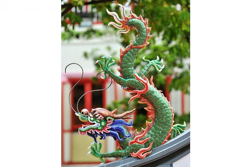 Dragon detail on the roof of the entrance gate.-- PHOTO: LIM YAOHUI FOR THE STRAITS TIMES