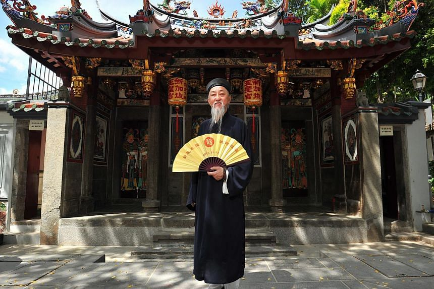 Master Lee Zhiwang, the president of the Taoist Mission (Singapore), standing in front of the Singapore Yu Huang Gong.-- PHOTO: LIM YAOHUI FOR THE STRAITS TIMES