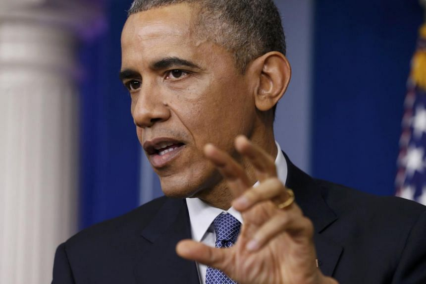 US President Barack Obama answers a question about the cyber attack on Sony Pictures after his end-of-year press conference in the briefing room of the White House in Washington, Dec 19, 2014. -- PHOTO: REUTERS