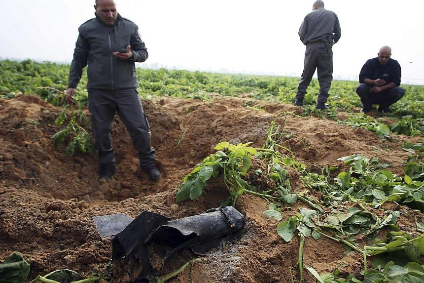 A rocket fired from Gaza hit an open field in southern Israel on Friday, Israeli police said, causing no casualties or damage. -- PHOTO: REUTERS