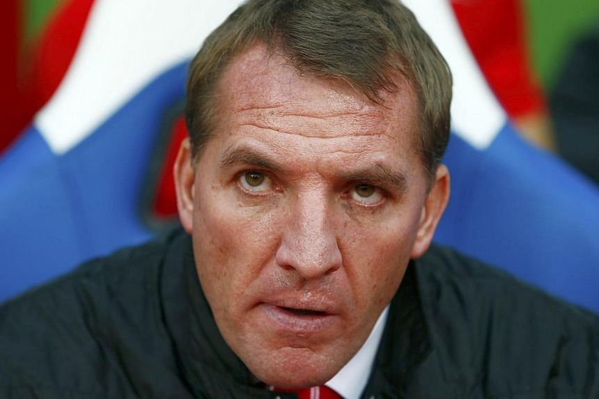 Brendan Rodgers (above) was in no mood to hang around as the under-pressure Liverpool manager made quick work of his weekly press conference on Friday. -- PHOTO: REUTERS
