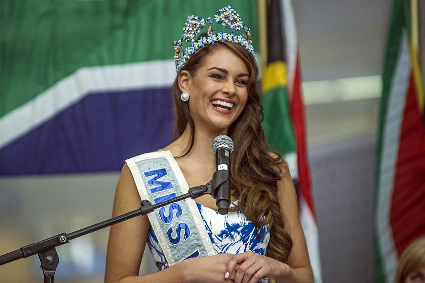 Rolene Strauss, the newly crowned Miss World 2014, gives a speech upon her arrival at OR Tambo International Airport, in Johannesburg on Dec 20, 2014. -- PHOTO: AFP