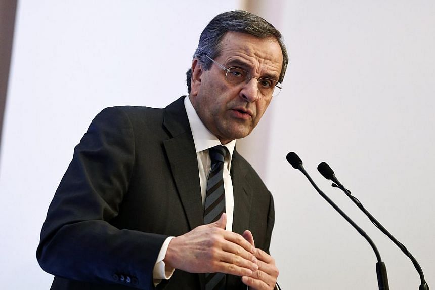 Prime Minister Antonis Samaras (above) said he would sue a popular comedian-turned-lawmaker who claimed he was offered money to help rig the presidential vote, allegedly on the premier's orders. -- PHOTO: REUTERS