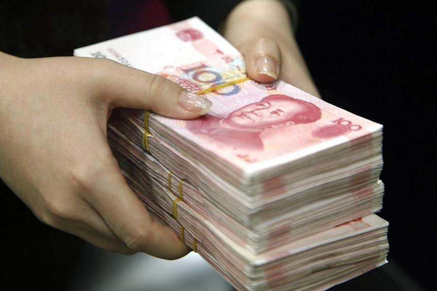 China has cut red-tape for foreign bank branch openings and entry into renminbi business, state media said on Saturday, the latest in a series of measures to liberalise the banking sector.-- PHOTO: BLOOMBERG