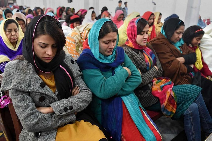 Pakistani Christians pray for the victims of the Peshawar school massacre at St. John's Cathedral in Peshawar on Dec 21, 2014. -- PHOTO: AFP