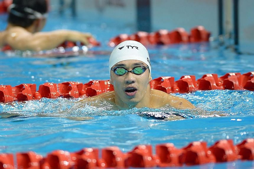 Swimmer Clement Lim posted a 28.54sec time in the men's 50m breaststroke,rewriting Lionel Khoo's 2012 mark of 28.90sec and qualifying for the SEA games.-- ST PHOTO: NG SOR LUAN