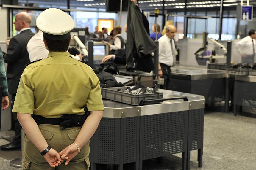 This photo taken on Feb 2, 2010, shows flight passengers at the security control at the airport in Frankfurt. An EU probe has found major security lapses at Germany's biggest airport in Frankfurt enabling weapons and other items to be smuggled t
