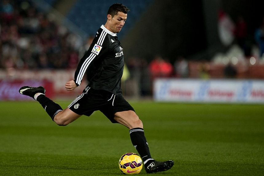 Real Madrid's Portuguese forward Cristiano Ronaldo kicks the ball during the Spanish league football match against UD Almeria on Dec 12, 2014, at Juegos Mediterraneos stadium in Almeria.Ronaldo, the World Player of the Year, returned to his hom