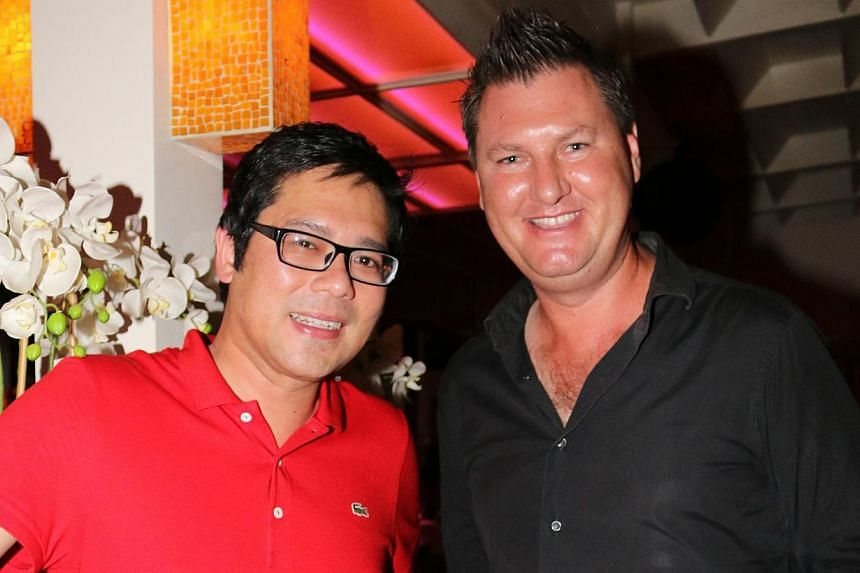 Group chief executive Sean Lee (with a friend, Australian landscape architect Anton Joel Clark) is intrigued by Bali's culture and traditions. -- PHOTO: COURTESY OF SEAN LEE