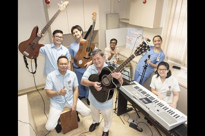 At Tan Tock Seng Hospital's jamming studio are (front row from left) nurse clinician Laley Senawi (cajon), nurse manager Chio Cheng Kay (guitar), registered nurse Grace Tan (keyboard); (back row, from left) nurse manager James Ang (bass guitar), st