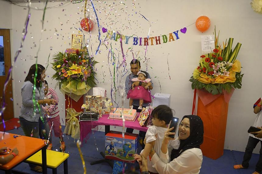 Draftsman Moksin Mohamed Mustafa (above) held his daughter's first birthday at Zoom Park Singapore, where the kids could play as much as they wanted.--ST PHOTO: MARK CHEONG