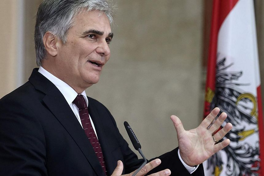 The head of Austria's government, Chancellor Werner Faymann,criticised fellow European Union countries on Saturday that are calling for tougher sanctions against Moscow, warning against pushing the Russian economy towards collapse. -- PHOTO: RE