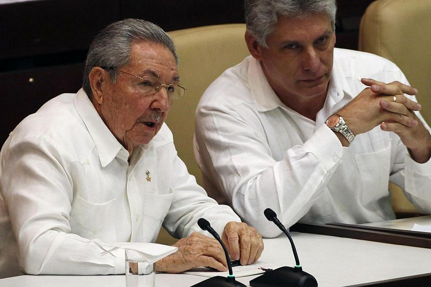 """Cuba's President Raul Castro (left) speaks with his first vice-president Miguel Diaz Canel during a session of the National Assembly in Havana, Dec 20, 2014.Castro told parliament on Saturday the country faces a """"long and difficult struggle"""" be"""