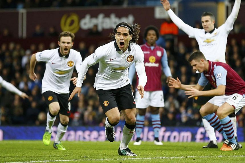 Manchester United's Radamel Falcao (centre) celebrates after scoring a goal during their English Premier League soccer match against Aston Villa at Villa Park in Birmingham, central England Dec 20, 2014. -- PHOTO: REUTERS