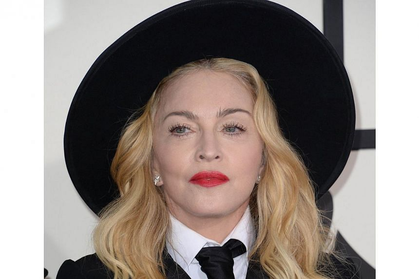 Madonna (above) on Saturday suddenly released six new songs months ahead of schedule, upset that early versions had leaked online. -- PHOTO: AFP