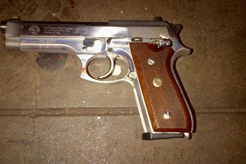 A silver semi-automatic Taurus firearm, which police said was recovered on the subway platform near the body of 28-year-old shooting suspect Ismaaiyl Brinsley. -- PHOTO: REUTERS
