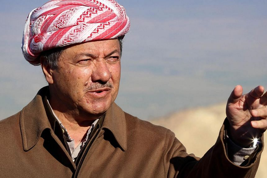 Iraqi Kurdish leader Masoud Barzani speaks to journalists today during a visit to Mount Sinjar in the autonomous Kurdistan region, in northwestern Iraq. Barzani hailed advances by peshmerga fighters against the Islamic State in Iraq and Syria (ISIS)