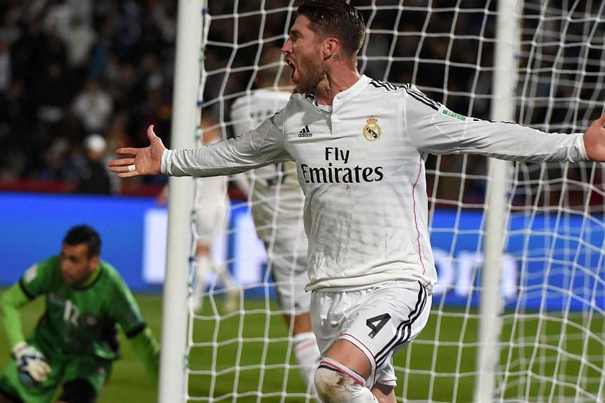 Real Madrid's defender Sergio Ramos scored the first goal with a thumping header from a corner. -- PHOTO: AFP