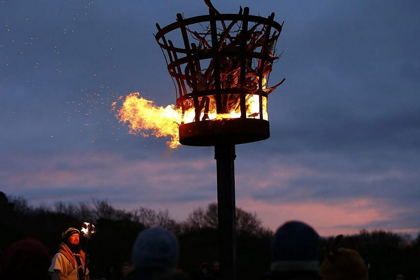 A gathering for a winter solstice ritual to mark the shortest day's sunlight on Beacon Hill near Loughborough, central England, on Dec 21, 2014. -- PHOTO: REUTERS