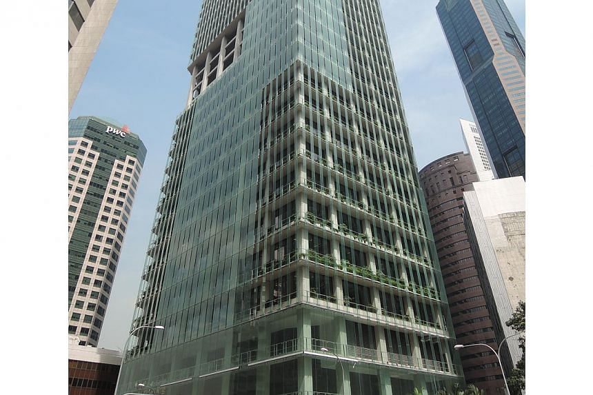 The building's energy-efficient double-skin façade comprises a primary curtain wall of glass and secondary layer of teeming planters that cuts solar heat gain by up to 26%. -- PHOTO: CAPITALAND