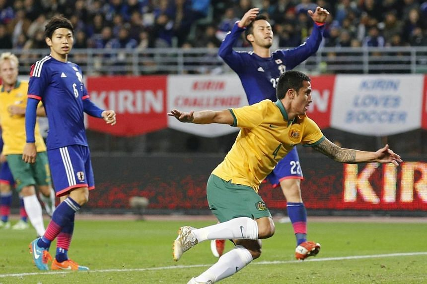 Tim Cahill (front right) of Australia celebrates after scoring against Japan during their international friendly soccer match in Osaka, western Japan on Nov 18, 2014.Australia's all-time leading goal-scorer Tim Cahill is feeling as fit as ever