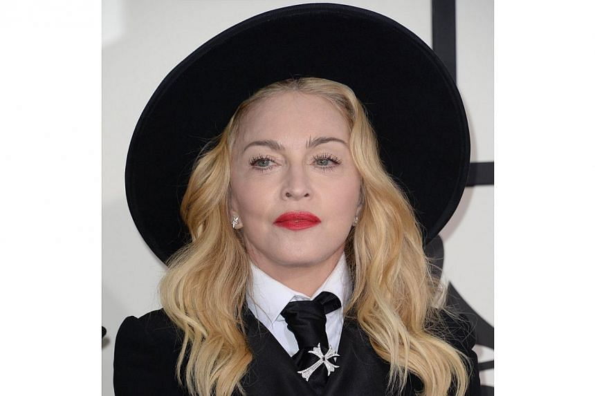 This Jan 26, 2014 file photo shows Madonna as she arrives on the red carpet for the 56th Grammy Awards at the Staples Center in Los Angeles. -- PHOTO: AFP